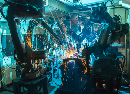 Team Robot welding movement Industrial automotive part in factory 스톡 콘텐츠
