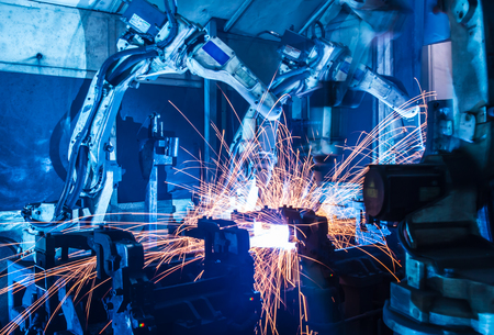 Welding robots movement in a car factory