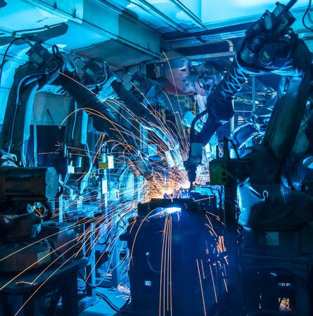 Team Welding robots movement in a car factory