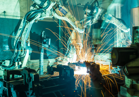 heavy industry: Welding robots movement in a car factory