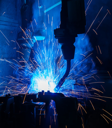 assembly line: Welding robots movement in a car factory