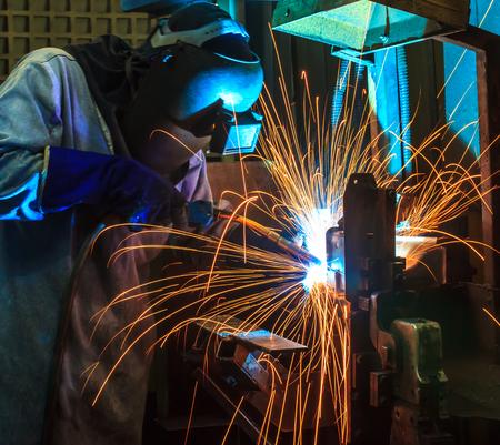 welding worker: welder Industrial automotive part in factory