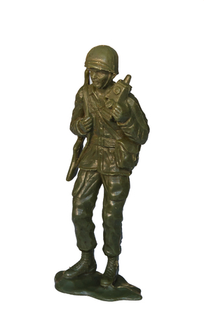 green plastic soldiers: miniature toy soldier on white background