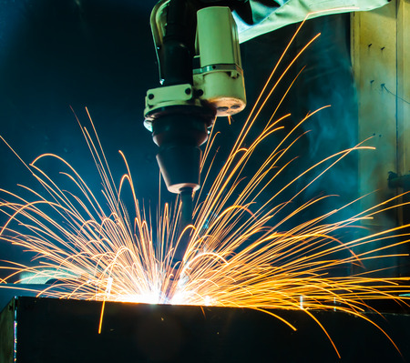 modern manufacturing: Welding robots movement in a car factory