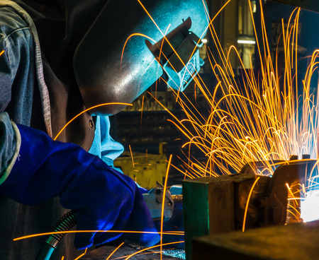 skilled labour: welder Industrial automotive part in factory
