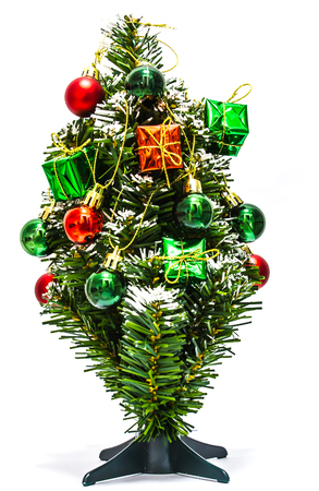 dacorated: Christmas tree with gifts boxes on white background.