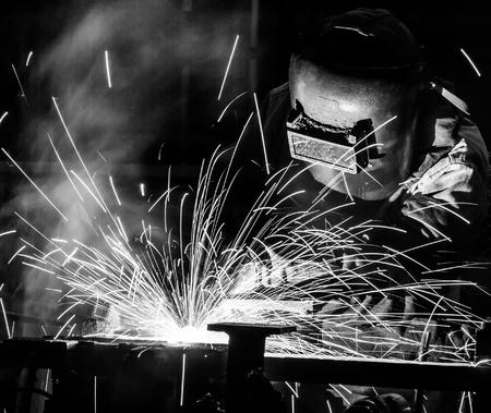 improvisation: welder Industrial automotive part in factory black white