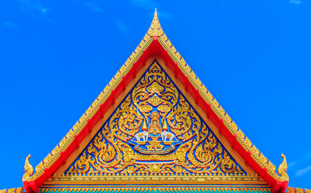 buddhist temple roof: Delicate Thai Art At Roof Top Of Buddhist Temple In Thailand Stock Photo