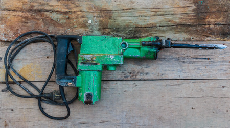 mounter: Electric hammer Plugger on old wood Stock Photo