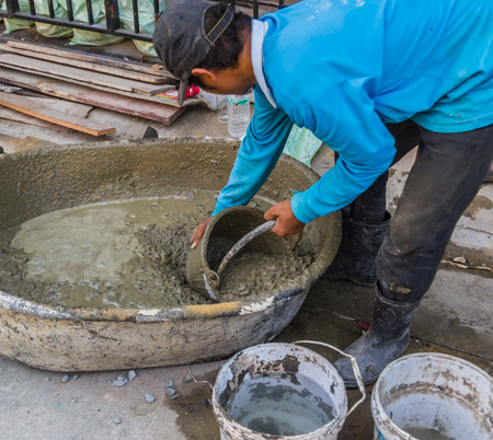 worker mixing cement