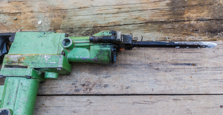 jack tar: Electric hammer Plugger on old wood Stock Photo