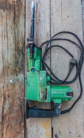 taskmaster: Electric hammer Plugger on old wood Stock Photo