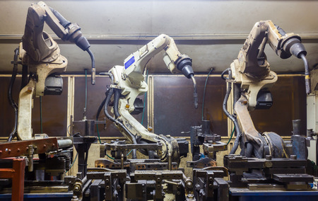 industry: Welding robots machine in a car factory Stock Photo