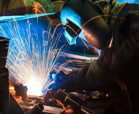 skilled: Skilled technicians welding Industrial automotive part in factory