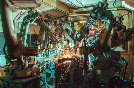 Soudage mouvements du robot dans une usine de voiture Banque d'images