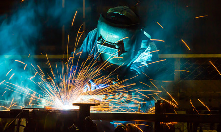 steel making: welder Industrial automotive part in factory