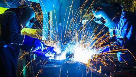 steel factory: welder Industrial automotive part in factory