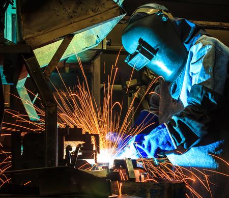 erection: welder Industrial automotive part in factory