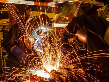 erection: welder teamwork steel in Industrial,cars
