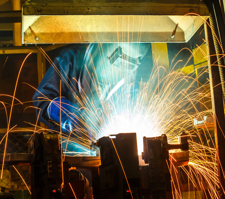 improvisation: Welding work in factory
