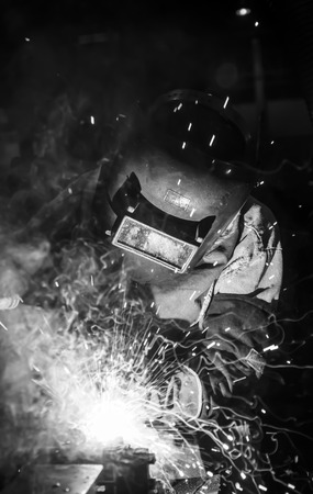 welding work in cars factory  industail black white