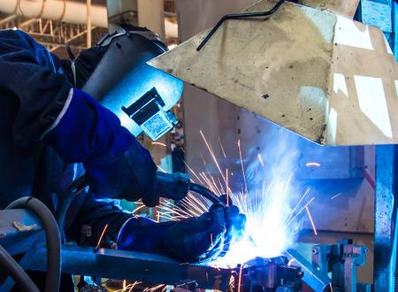 welded: Welding work Industrial automotive part in factory
