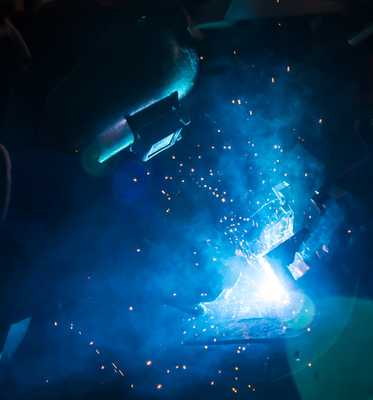 erection: welding work in cars factory  industail Stock Photo
