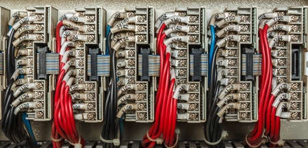 plc: Wiring PLC Control panel with wires industrial factory Stock Photo