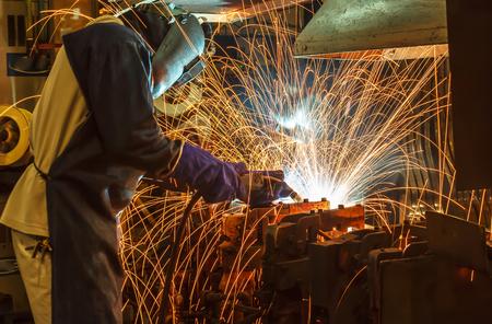 welder Industrial movement welding automotive part in factory