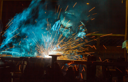 erecting: welder Industrial automotive part in factory