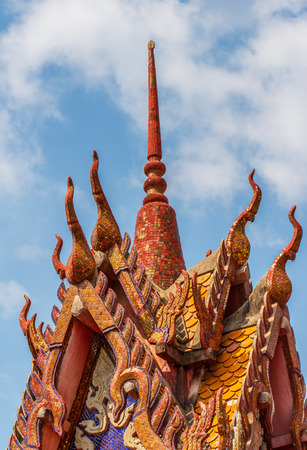 Detail of a traditional buddhist temple roof in thailand Stock Photo