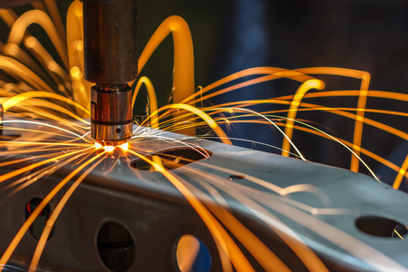 Industrial, automotive spot welding, in a car factory with sparks, manufacturing, industry