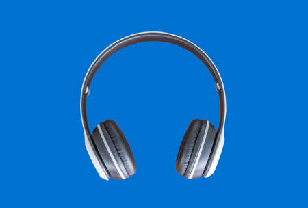 White wireless Headphones on a blue background 스톡 콘텐츠