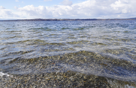 starnberger see: Stones in the water of the lake Starnberger See in Bavaria Stock Photo