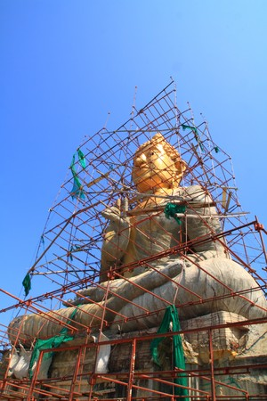 gold Buddha under construction at top of the mountain, Phetchaburi Thailand Stock Photo - 6948350