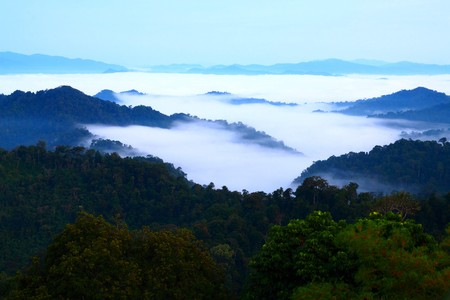 far away look: View of far away blue mountains in the fog, it look like the sea, Thailand.