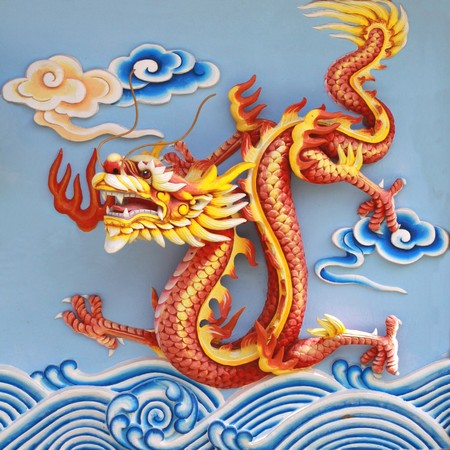 colorful chinese dragon at the wall of temple, Thailand