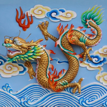 colorful chinese dragon in the wall of temple, Thailand photo