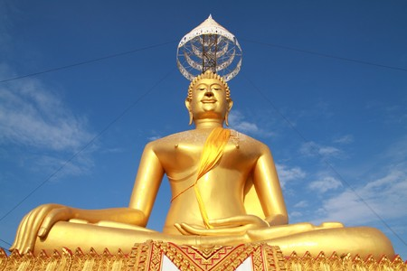 big golden Buddha stay at top of the mountain, Thailand photo