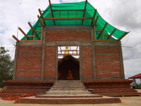 temple with brick wall in progress, Thailand photo