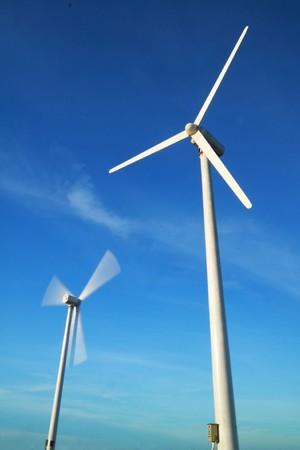 standstill: two wind turbines one is motion another is standstill. Stock Photo