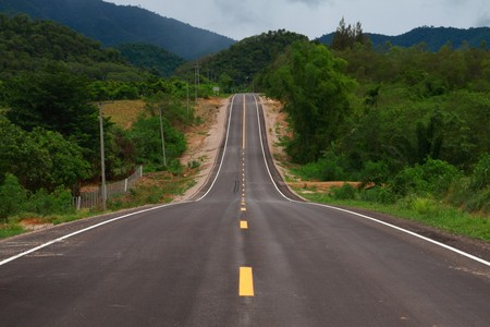 Long hilly road passes through green countryside Stock Photo - 7131375