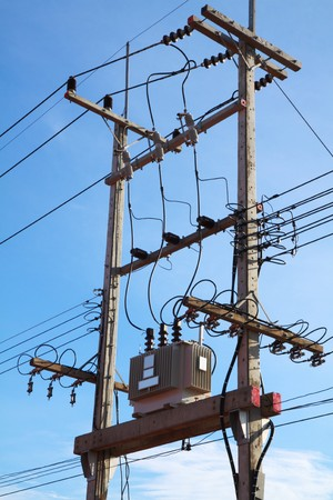 transformator: Transformer sub-station outdoor on the post with power line. Stock Photo