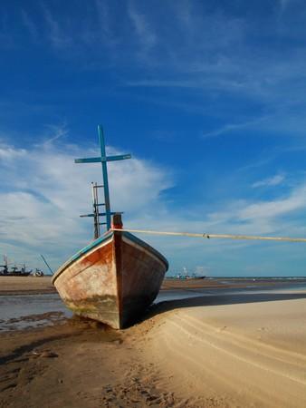 fisherman boat lying on the tropical beach