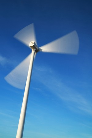 motion blade of modern win turbine in windy day with blue sky. photo