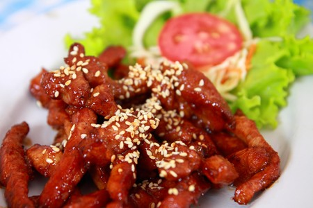 Closeup of fresh fried pork with sesame, thai food photo