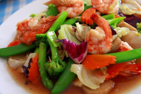 Close-up of colorful stir fry of shrimp and clolorful Vegetables, Thai food. Stock Photo