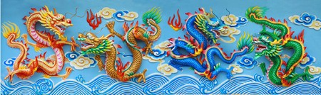 four color chinese dragon statue, red green gold and blue chinese statue at the wall of chinese temple in Thailand. photo