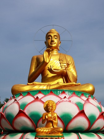 small and big golden buddha in chinese style with clear sky,Rachaburi Thailand. Stock Photo - 7420047