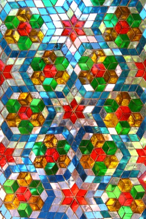 glass ornament: color mosiac glass pattern on the wall of thai temple Editorial